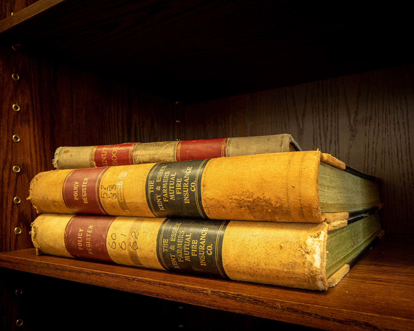 Three really old books stacked on top of each other