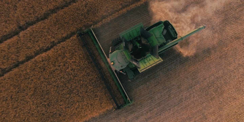 Tractor harvesting crops in field