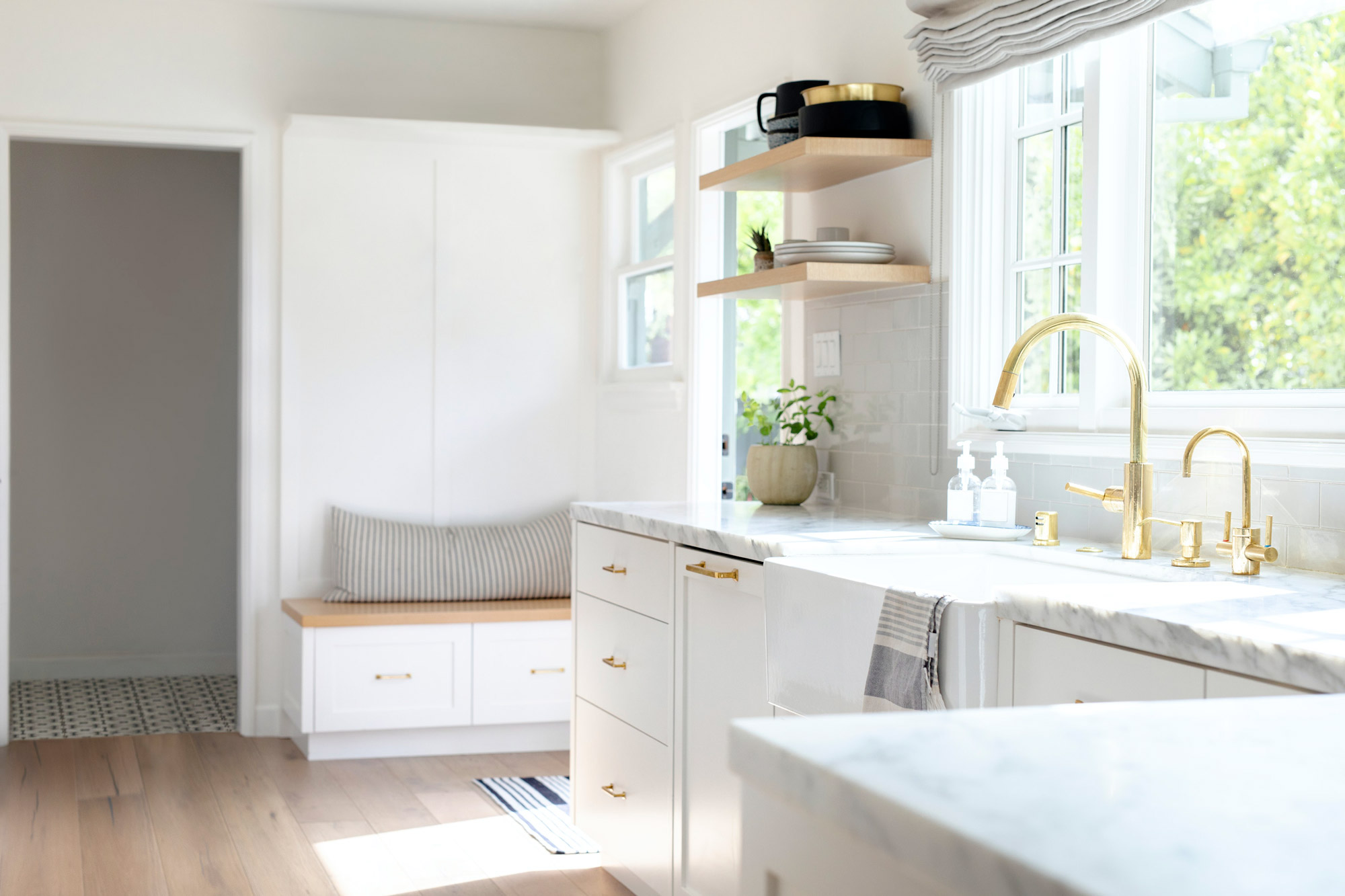 Kitchen adorned with marble tops and brass furnishings
