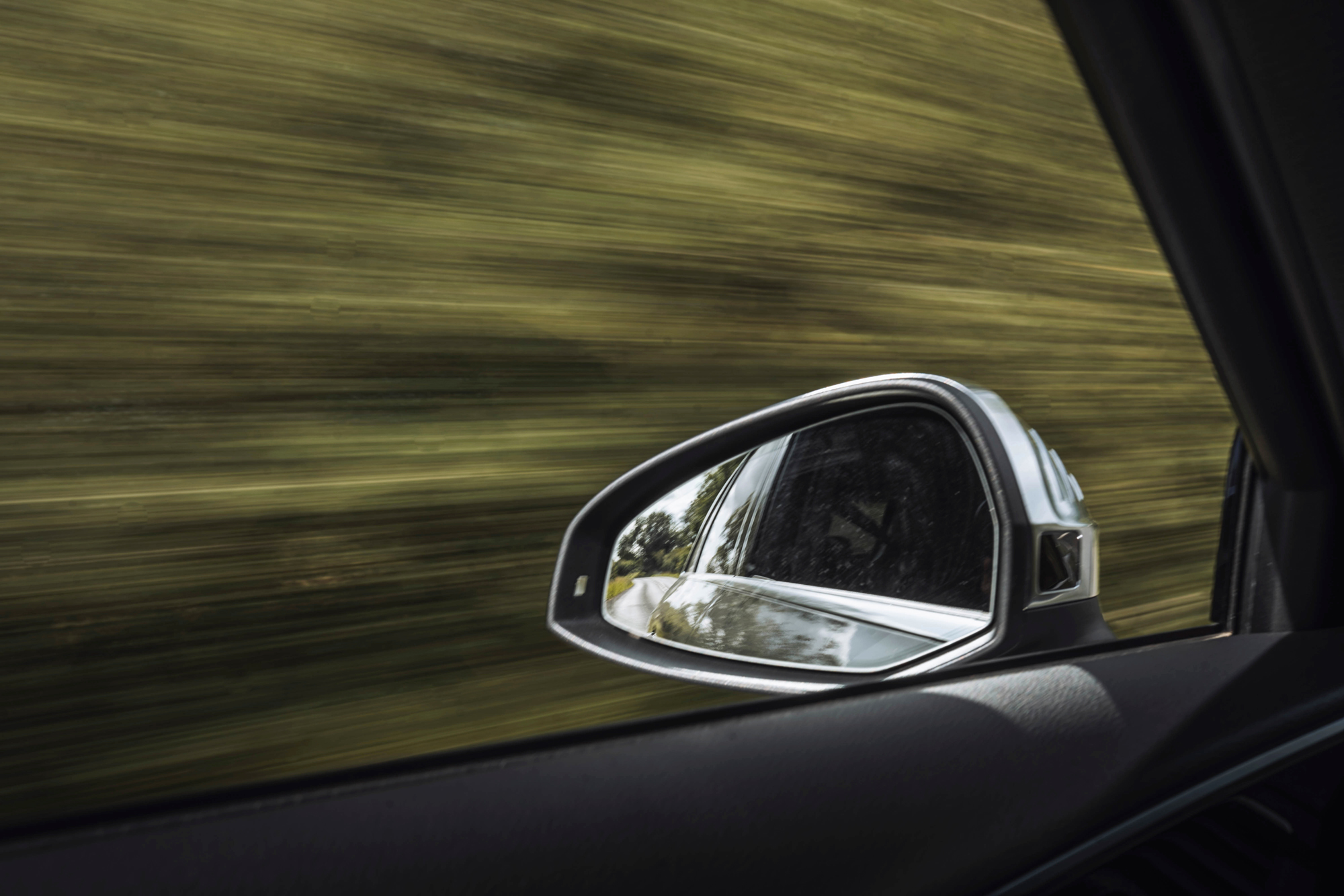 Image of a car with a blurred background from speed