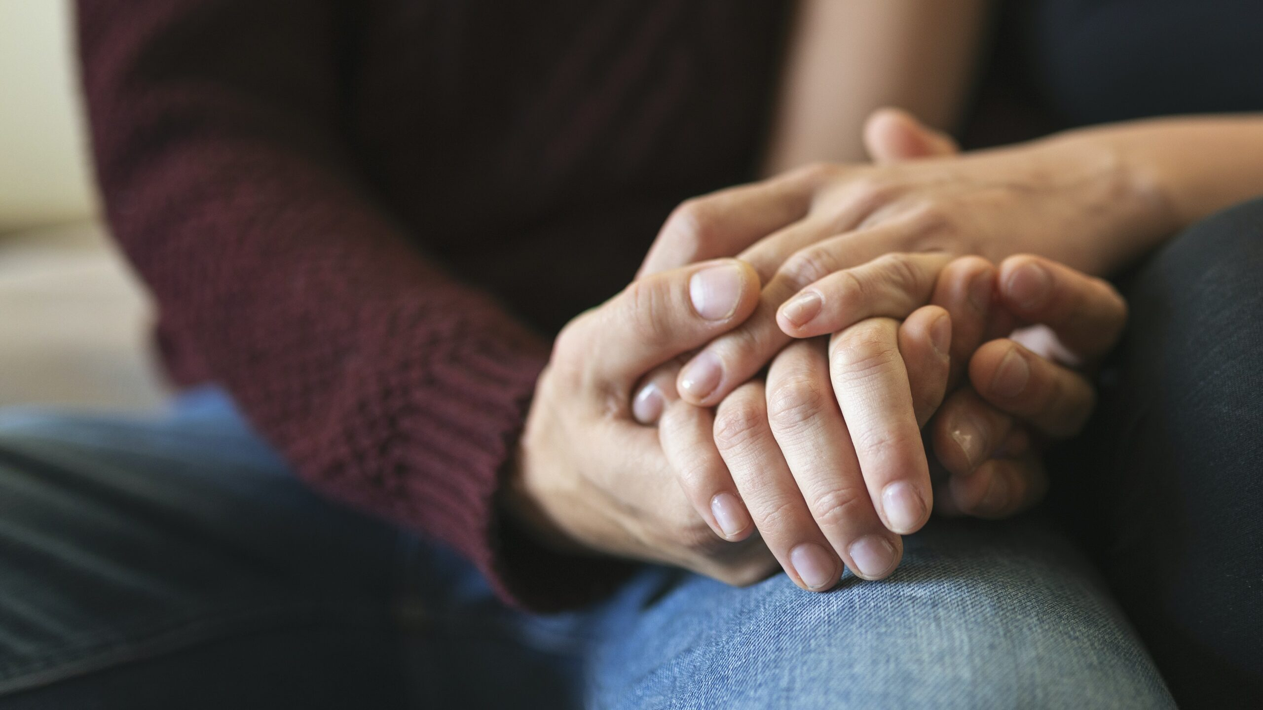 Close up shot of couple holding hands