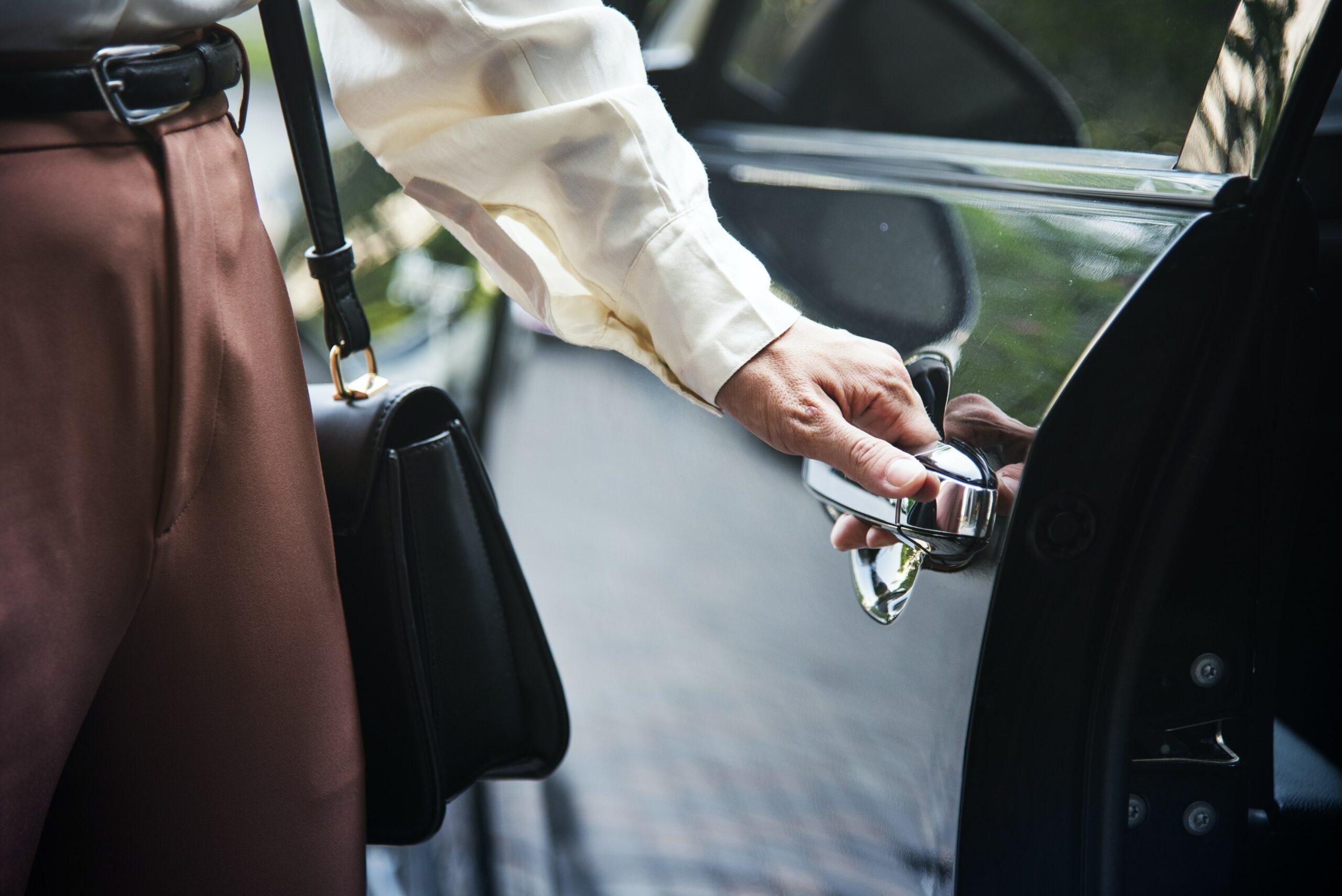 Close up shot of person opening car door